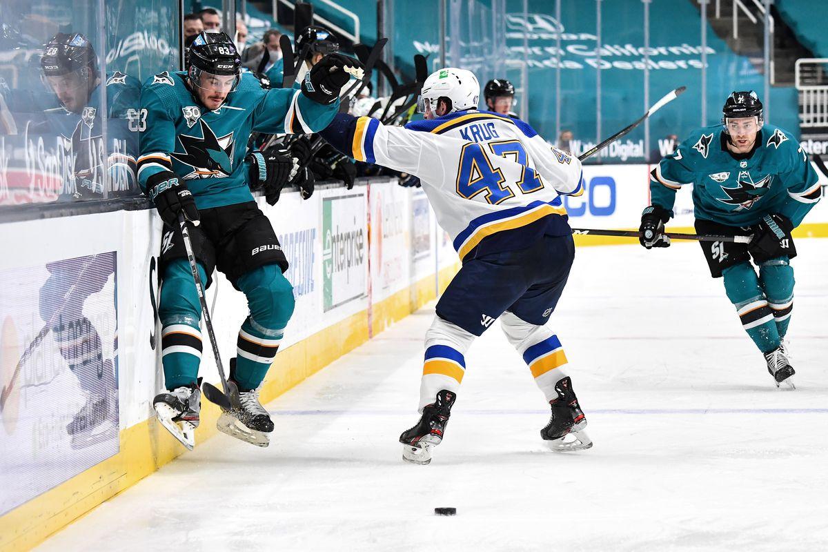 Torey Krug #47 of the St. Louis Blues shoves Matt Nieto #83 of the San Jose Sharks at SAP Center on March 8, 2021 in San Jose, California.