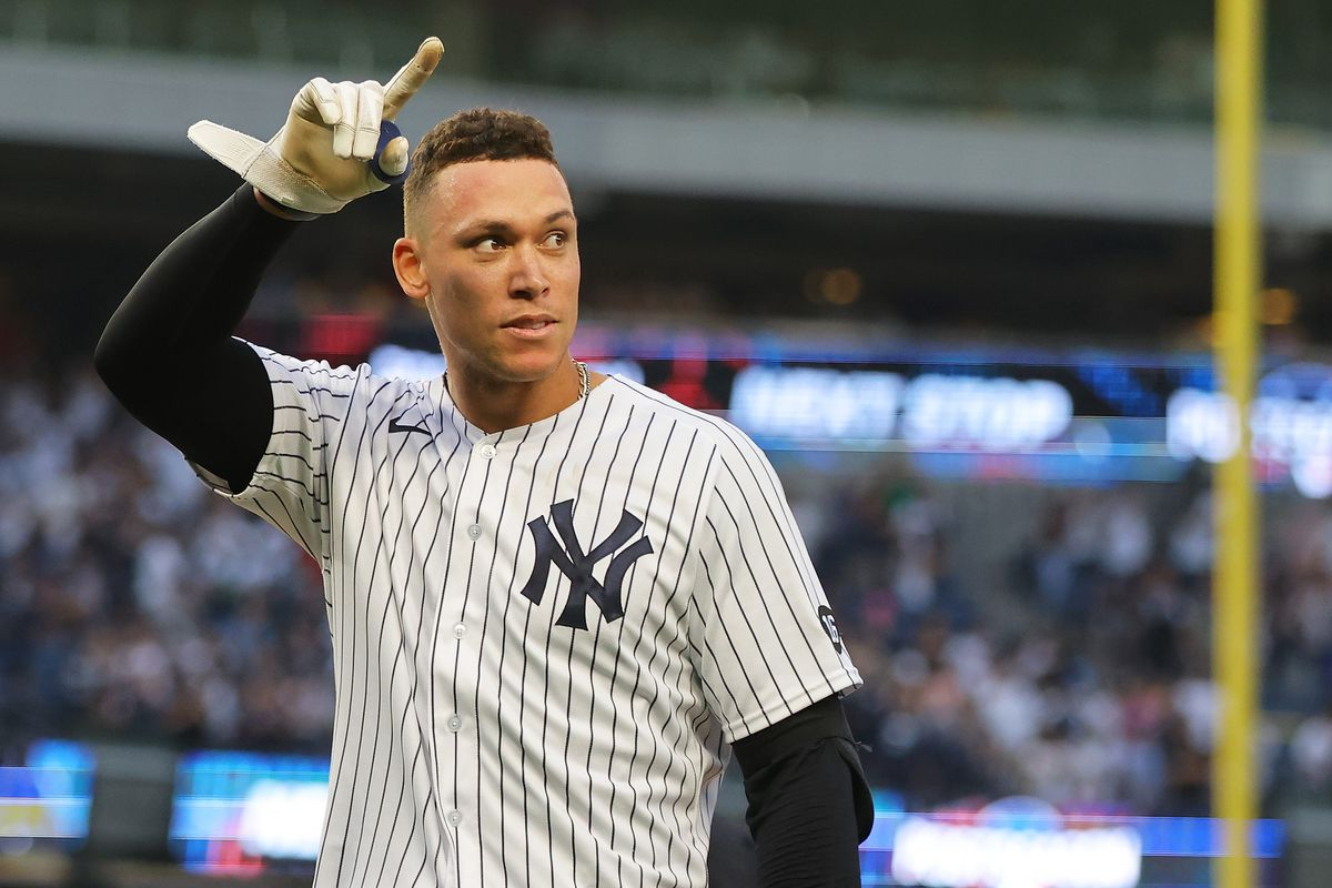 Aaron Judge #99 of the New York Yankees celebrates after hitting a walk-off single in the bottom of the ninth inning to beat the Tampa Bay Rays 1-0 at Yankee Stadium on October 03, 2021 in New York City.
