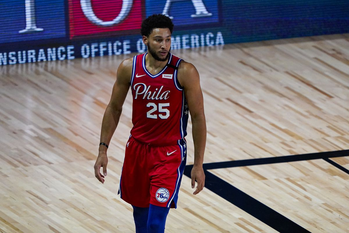 Ben Simmons of the Philadelphia 76ers walks up the court during the first half of an NBA basketball game against the Washington Wizards at The Arena at ESPN Wide World Of Sports Complex on August 5, 2020 in Lake Buena Vista, Florida.