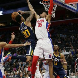 Utah Jazz guard Jordan Clarkson (00) goes to the basket against Detroit Pistons forward Christian Wood (35) during the second half of an NBA basketball game Saturday, March 7, 2020, in Detroit. The Jazz defeated the Pistons 111-105.