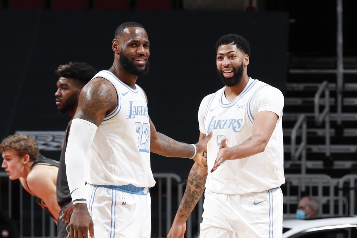 LeBron James #23 and Anthony Davis #3 of the Los Angeles Lakers high five during the game against the Chicago Bulls on January 23, 2021 at United Center in Chicago, Illinois.