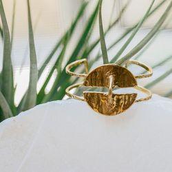 "<a href=""http://odetteny.com/crater-cuff-brass.html"">Crater Cuff</a> in recycled brass, $195"