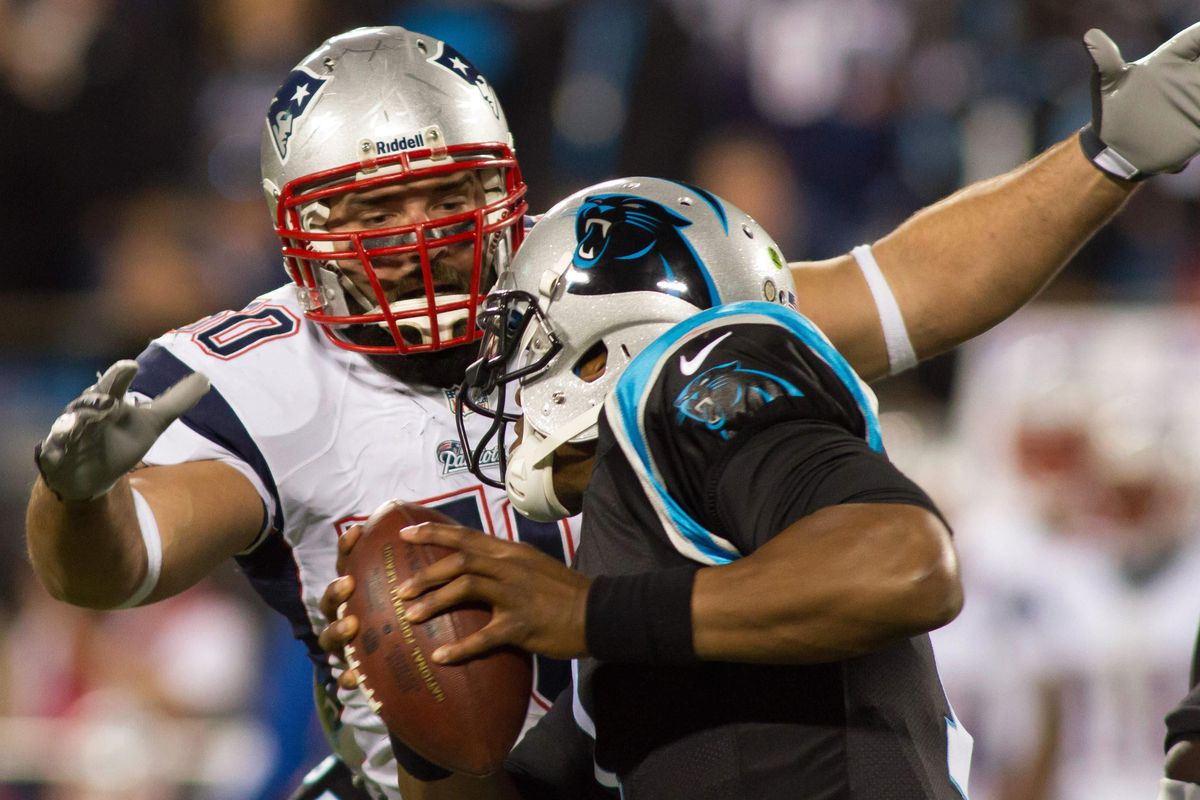 Rob Ninkovich closes in for the sack.