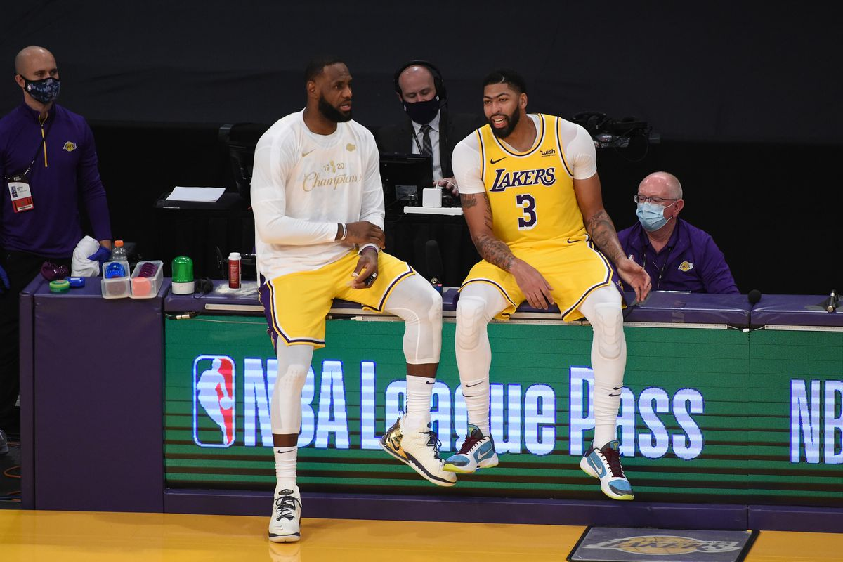 LeBron James and Anthony Davis of the Los Angeles Lakers share a conversation during a game against the LA Clippers on December 22, 2020 at STAPLES Center in Los Angeles, California.