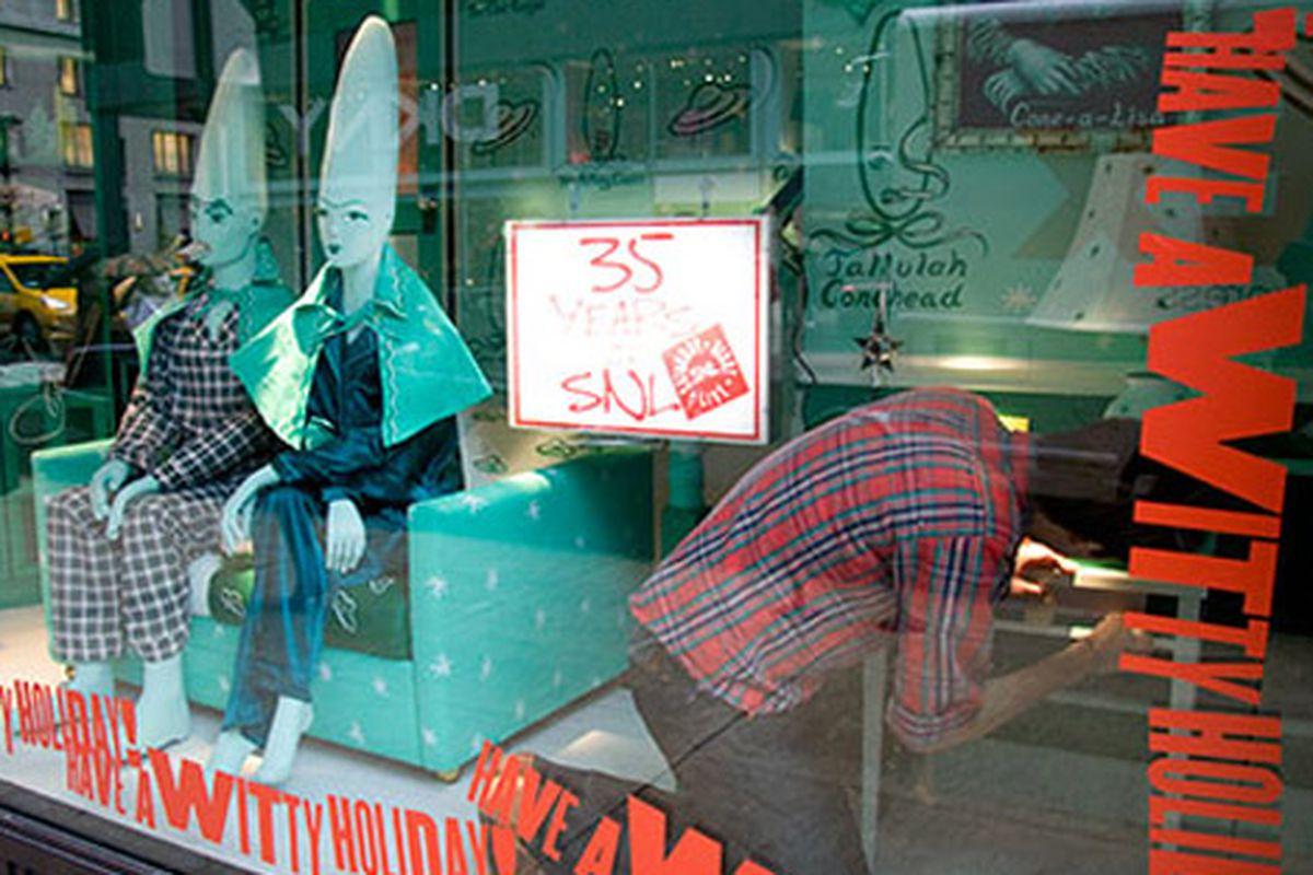 "A worker installs Barneys' SNL-themed holiday windows.  Image via <a href=""http://www3.timeoutny.com/newyork/tonyblog/2009/11/photos-barneys-saturday-night-live-holiday-windows/"">TONY</a>"