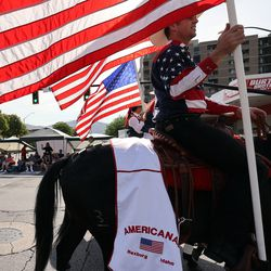 Members of the Americanas, from Rexburg, Idaho, carry American flags during the Days of '47 Parade in Salt Lake City on Friday, July 23, 2021.