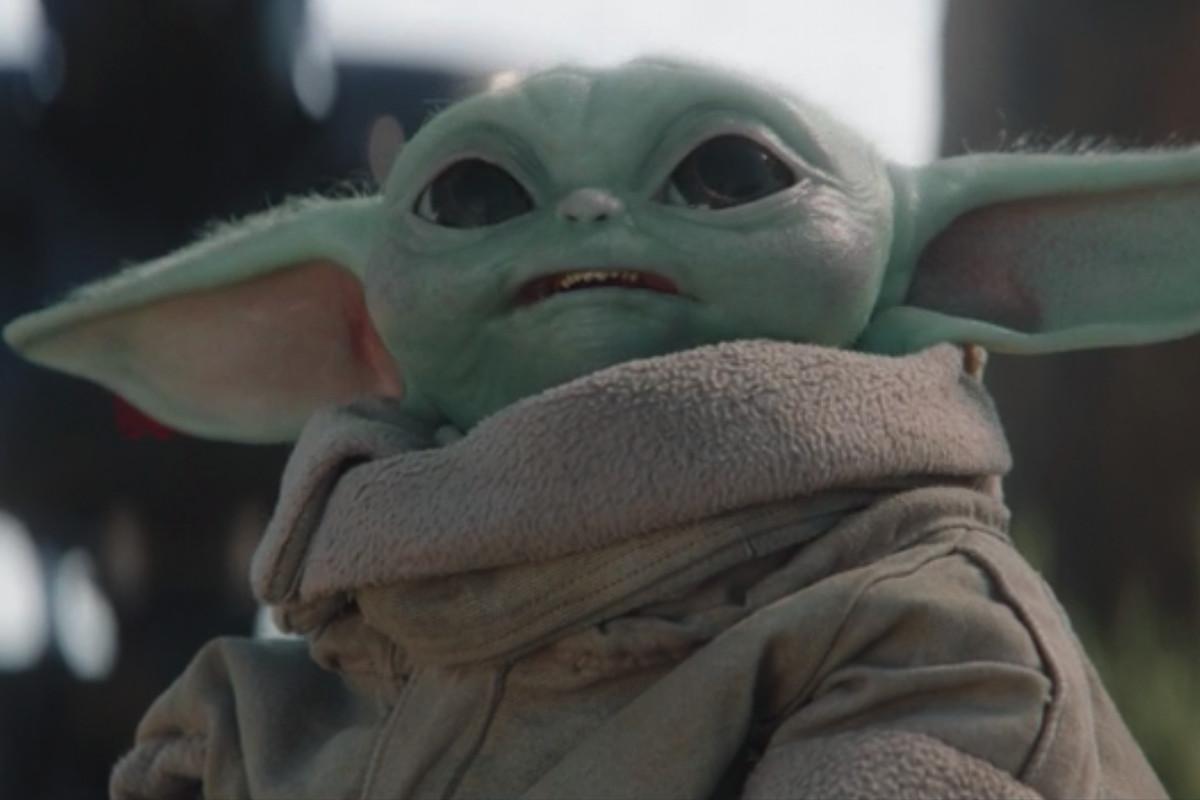 Grogu aka Baby Yoda looks up at an Imperial adversary in The Mandalorian