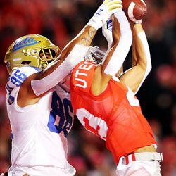 Utah Utes defensive back Julian Blackmon (23) makes an interception in front of UCLA Bruins tight end Devin Asiasi (86) in the end zone as Utah and UCLA play a college football game in Salt Lake City at Rice-Eccles Stadium on Saturday, Nov. 16, 2019.