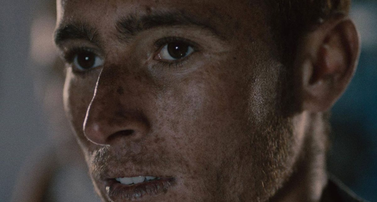 A close-up on a freckled boy's face.