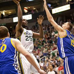 Jazz Al Jefferson (25) goes up for a basket over Warriors center Andris Biedrins (15) during the first half of the NBA basketball game between the Utah Jazz and the Golden State Warriors at Energy Solutions Arena, Wednesday, Dec. 26, 2012.