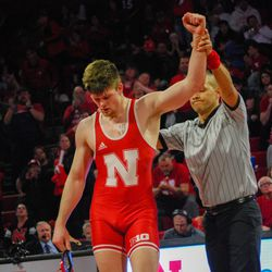 Nebraska's Taylor Venz gets his hand raised after winning against Michigan's Jelani Embree at 184-pounds Friday at the Devaney Sports Center.