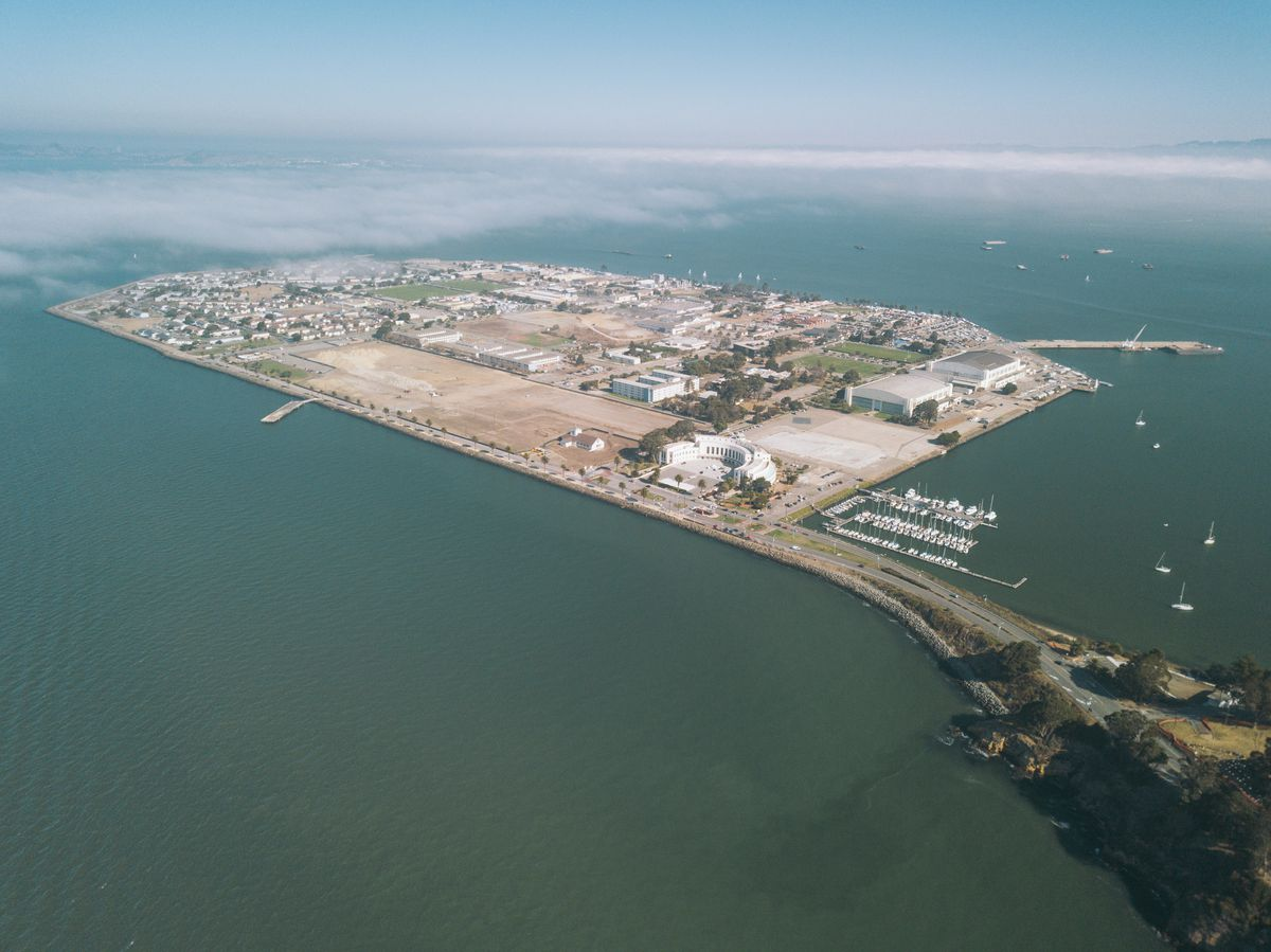 Aerial view of the flat Treasure Island in the middle of the SF Bay.