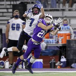 A pass intended for Pleasant Grove's Kolton Bayles slips past Lehi's Kadiyon Sweat during a football game at Lehi High School in Lehi on Friday, Sept. 11, 2020. Pleasant Grove won 35-29 in overtime.