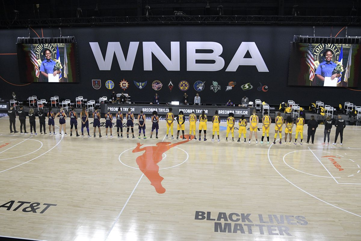 Members of the Phoenix Mercury and Los Angeles Sparks stand for a moment of silence in honor of Breonna Taylor before a game last month.