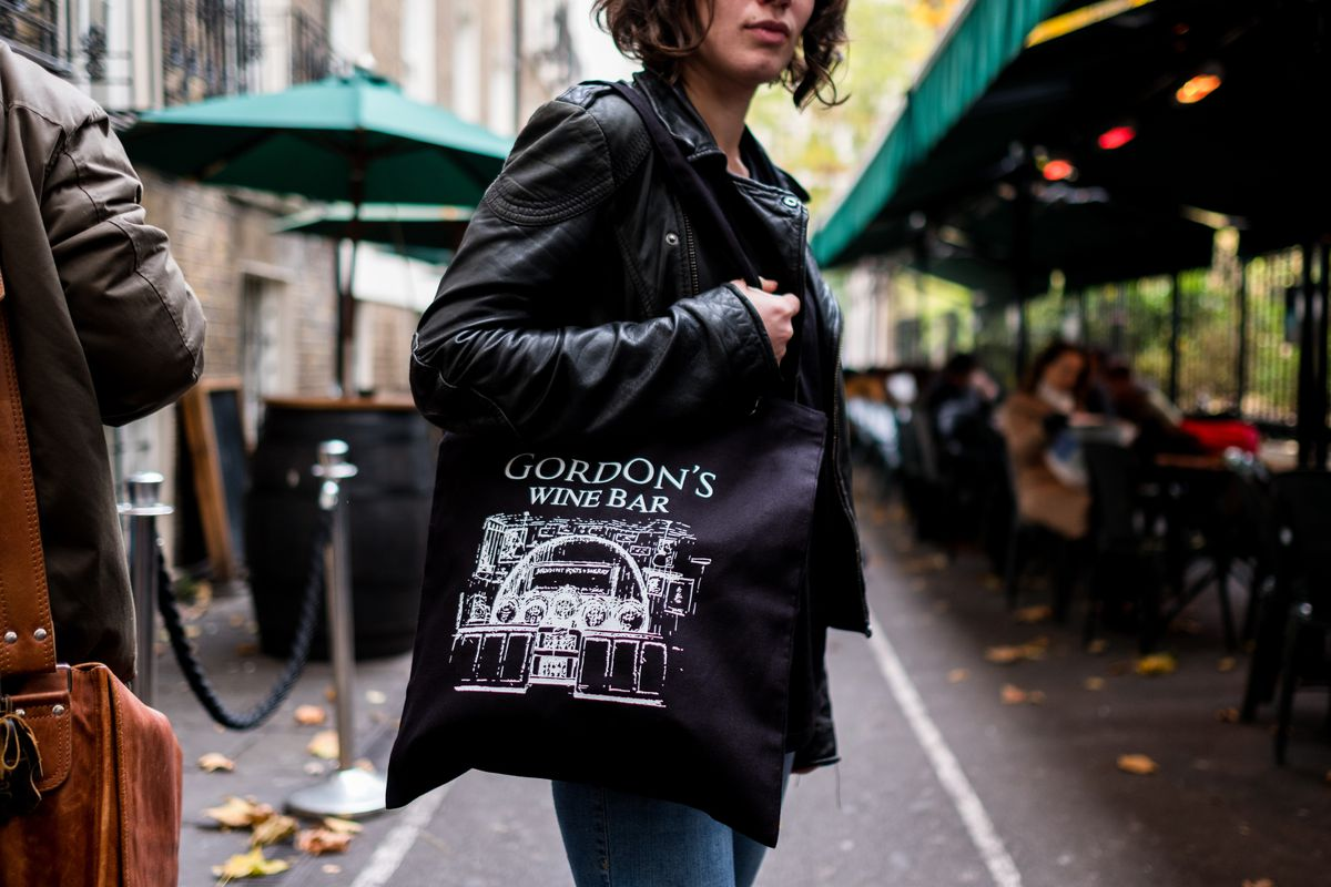 This tote bag from Gordon's wine bar is some of the best restaurant merch to buy in London