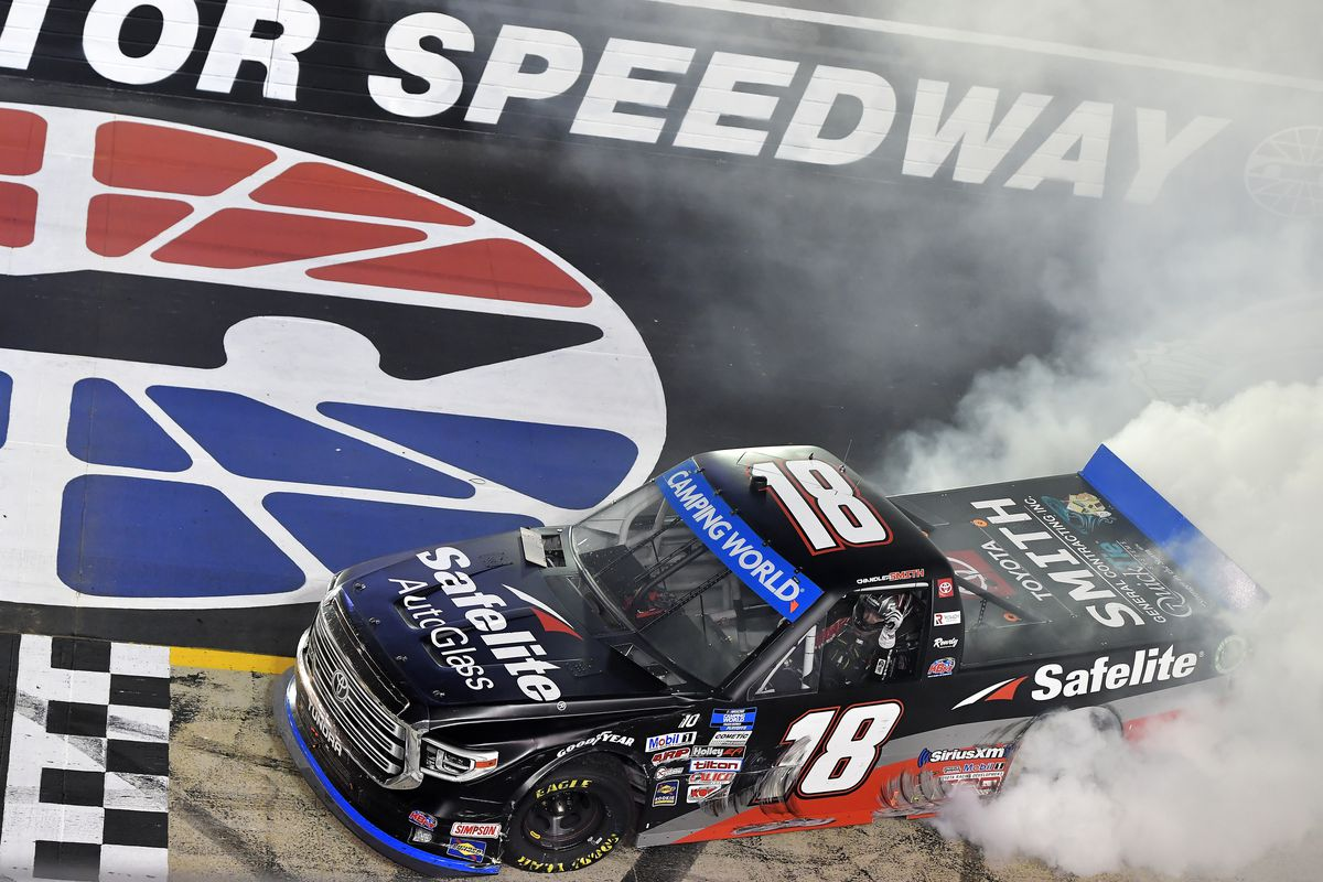 Chandler Smith, driver of the #18 Safelite AutoGlass Toyota, celebrates with a burnout after winning the NASCAR Camping World Truck Series UNOH 200 presented by Ohio Logistics at Bristol Motor Speedway on September 16, 2021 in Bristol, Tennessee.