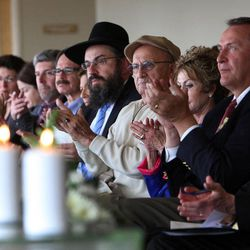 The audience applauds a speech by John Price during a Utah Holocaust Memorial Commemoration at the Jewish Community Center in Salt Lake City, Thursday, April 19, 2012.