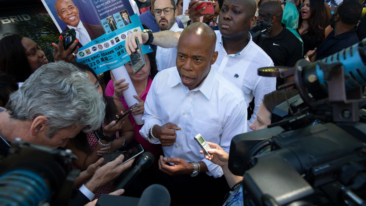 Brooklyn Borough President Eric Adams answers media questions after a mayoral campaign event at Cadman Plaza was disrupted by protesters, June 16, 2021.