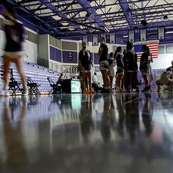 Riverton players stand on the court after power went out at the start of the girls basketball game between Riverton and Syracuse at Riverton High School on Tuesday, Dec. 15, 2020.