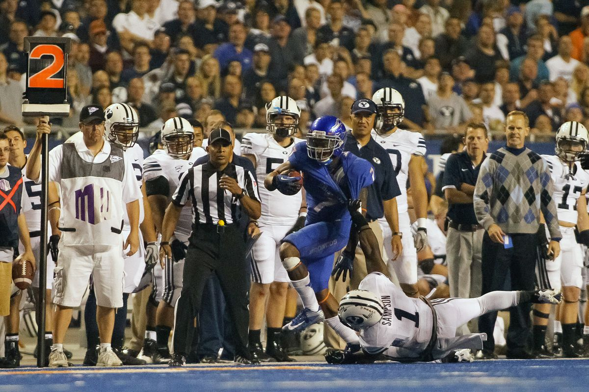 BOISE, ID - SEPTEMBER 20:  D.J. Harper #7 of the Boise State Broncos is grabbed by Joe Sampson #1 of the BYU Cougars at Bronco Stadium on September 20, 2012 in Boise, Idaho.  (Photo by Otto Kitsinger III/Getty Images)