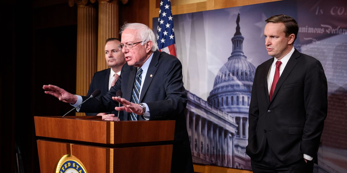 Sen. Bernie Sanders (I-VT), flanked by Sen. Mike Lee (R-UT) and Sen. Chris Murphy (D-CT), speaks after the Senate voted to withdraw support for Saudi Arabia's war in Yemen on December 13, 2018.