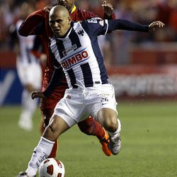 Andy Williams of Real Salt Lake fights for control of the ball against Humberto Suazo from the Rayados of Monterrey during the final game of the CONCACAF championship at Rio Tinto Stadium in Sandy Wednesday, April 27, 2011.