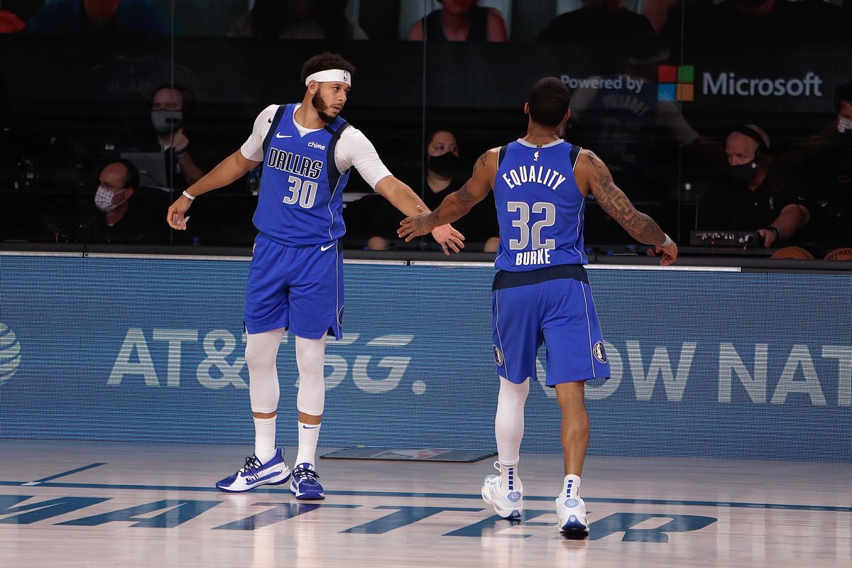 Seth Curry and Trey Burke of the Dallas Mavericks in the game against the LA Clippers for Game five of the first round of the 2020 Playoffs as part of the NBA Restart 2020 on August 25, 2020 at AdventHealth Arena at ESPN Wide World of Sports Complex in Orlando, Florida.