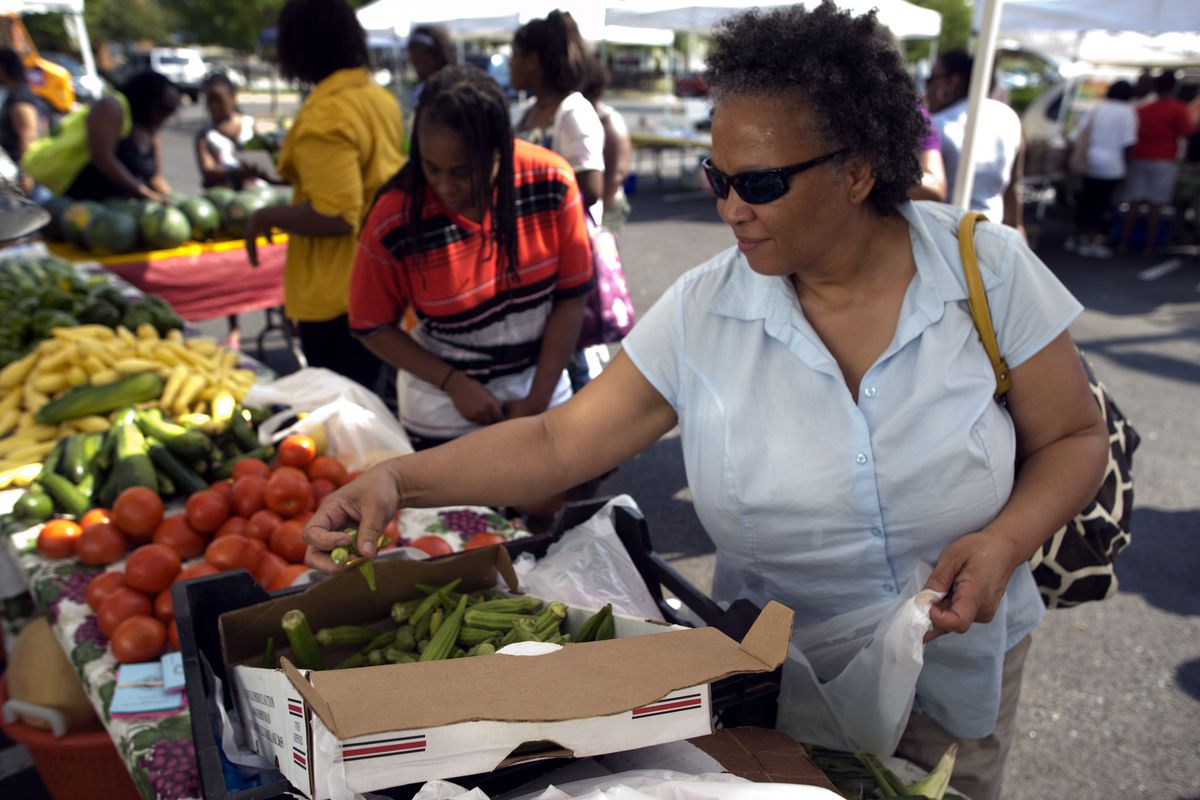 WIC Program Participants Use Their State Issued Vouchers At Farmers Markets In Washington DC