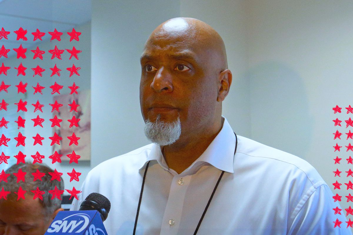 MLBPA executive Tony Clark standing at a microphone.