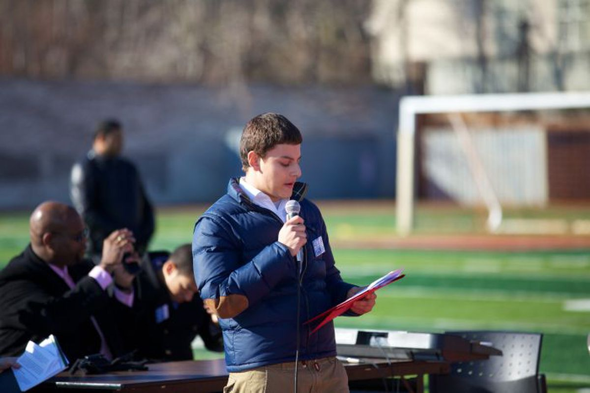 Justin Zemser speaks to students at a College March while in high school.
