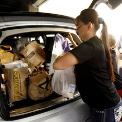 Kristie Madsen unloads donated food for the Utah Food Bank at Walmart in Salt Lake City on Saturday, Sept. 29, 2012.  Hunger Action Month in Utah culminated with this statewide food drive at Walmart locations throughout the state.