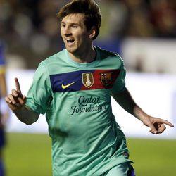 Barcelona's Lionel Messi from Argentina celebrates after scoring against Levante during their La Liga soccer match at Ciutat de Valencia stadium in Valencia, Spain, Saturday, April 14, 2012.