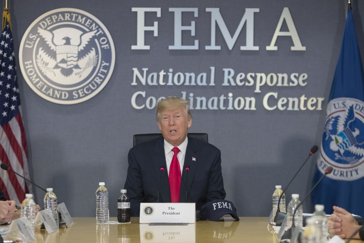Trump visits FEMA ahead Hurricane Harvey. Photo by Michael Reynolds - Pool/Getty Images