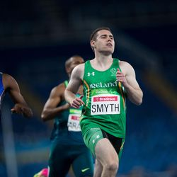 Irish athlete Jason Smith, right, runs to win the second heat of the men's 100-meter T13 athletic event of the Rio Paralympic games in Rio de Janeiro, Brazil, Thursday, Sept. 8, 2016.