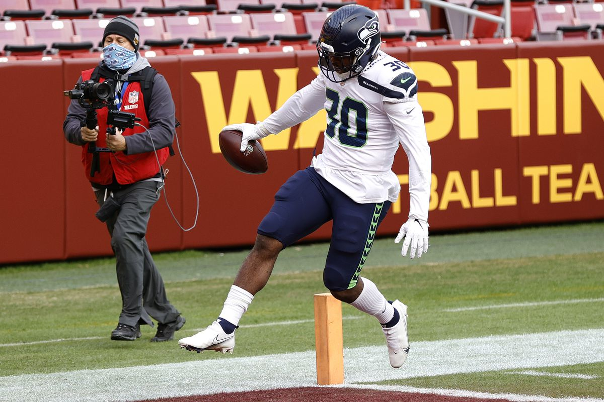 Carlos Hyde #30 of the Seattle Seahawks scores a touchdown against the Washington Football Team at FedExField on December 20, 2020 in Landover, Maryland.