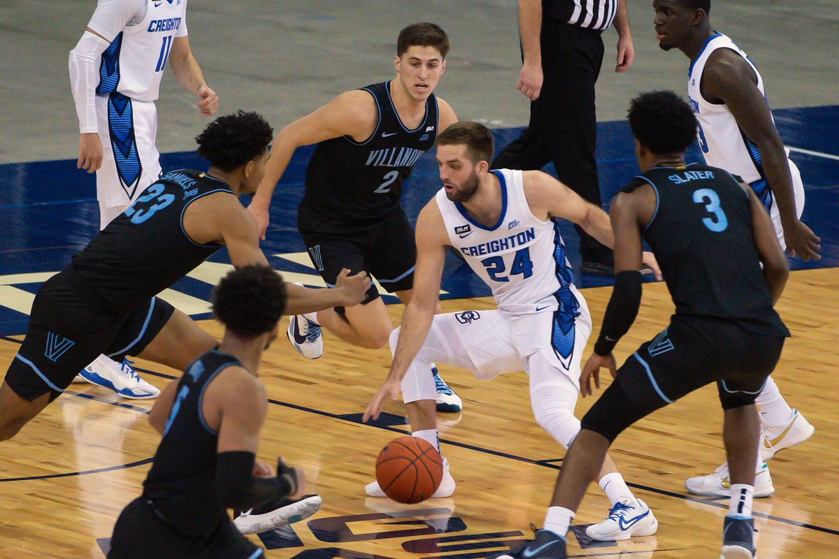 Creighton Bluejays guard Mitch Ballock dribbles between Villanova Wildcats forward Jermaine Samuels and guard Collin Gillespie and forward Brandon Slater in the second half at CHI Health Center Omaha.