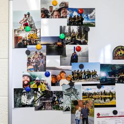 A whiteboard with a collection of photos displaying Unified firefighters, family and friends is pictured at Station 127 at Camp Williams on Thursday April 29, 2021.