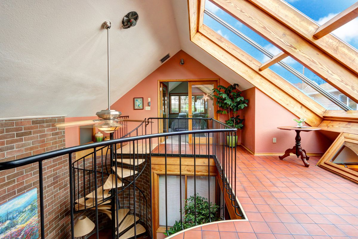 A loft space with large skylights and French doors