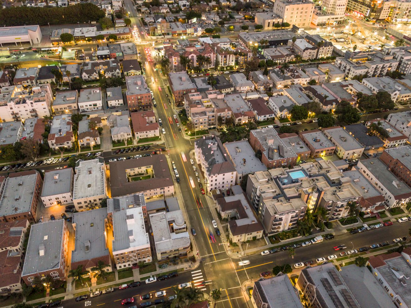 """SB 50 would override local zoning rules, allowing developers to build apartments and condos near train stations and some """"high-capacity"""" bus stops."""