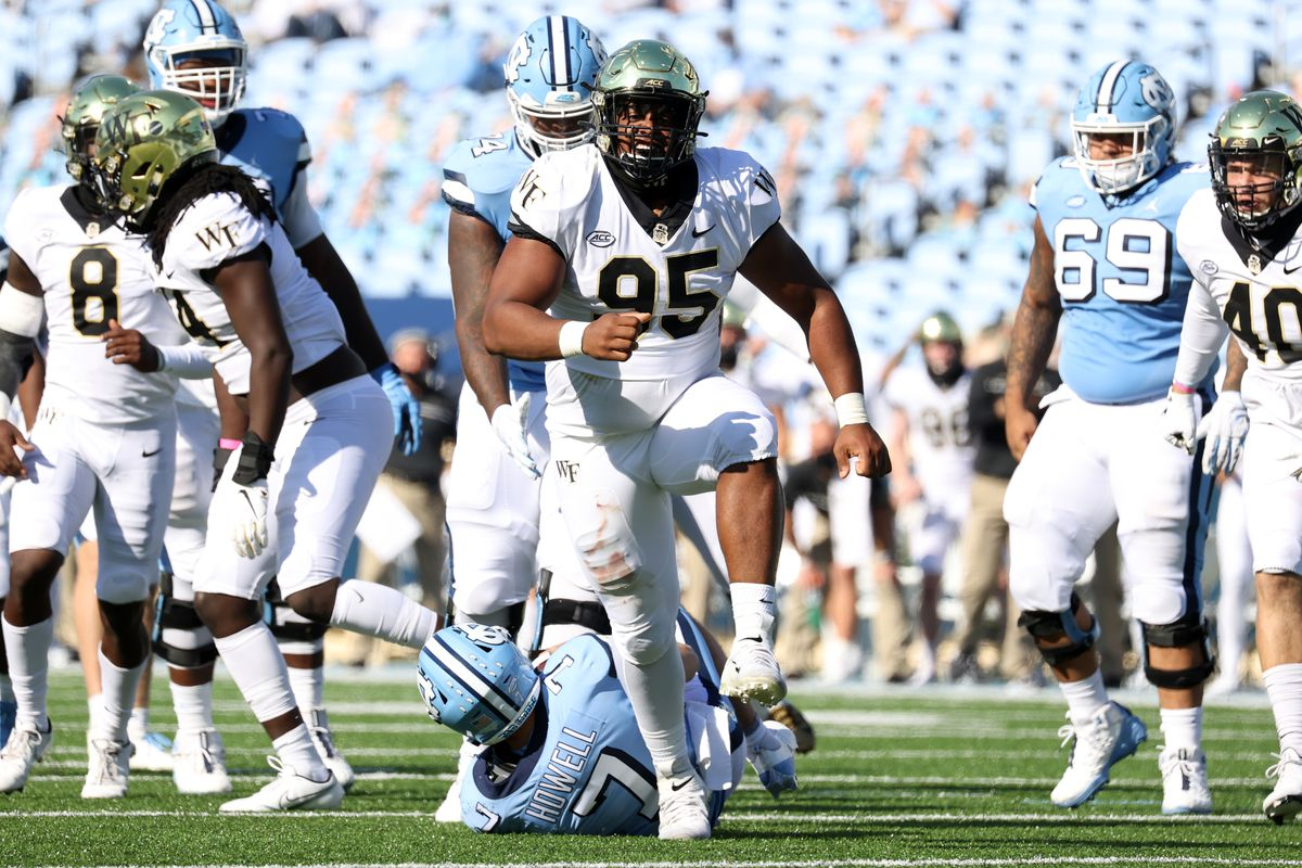 Dion Bergan Jr. #95 of Wake Forest celebrates his sack of Sam Howell #7 of North Carolina during a game between Wake Forest and North Carolina at Kenan Memorial Stadium on November 14, 2020 in Chapel Hill, North Carolina.