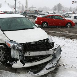 Slick roads caused hazardous driving conditions and fender benders like this one on the corner of 9000 South and State Street in Sandy on Thursday, Dec. 19, 2013.