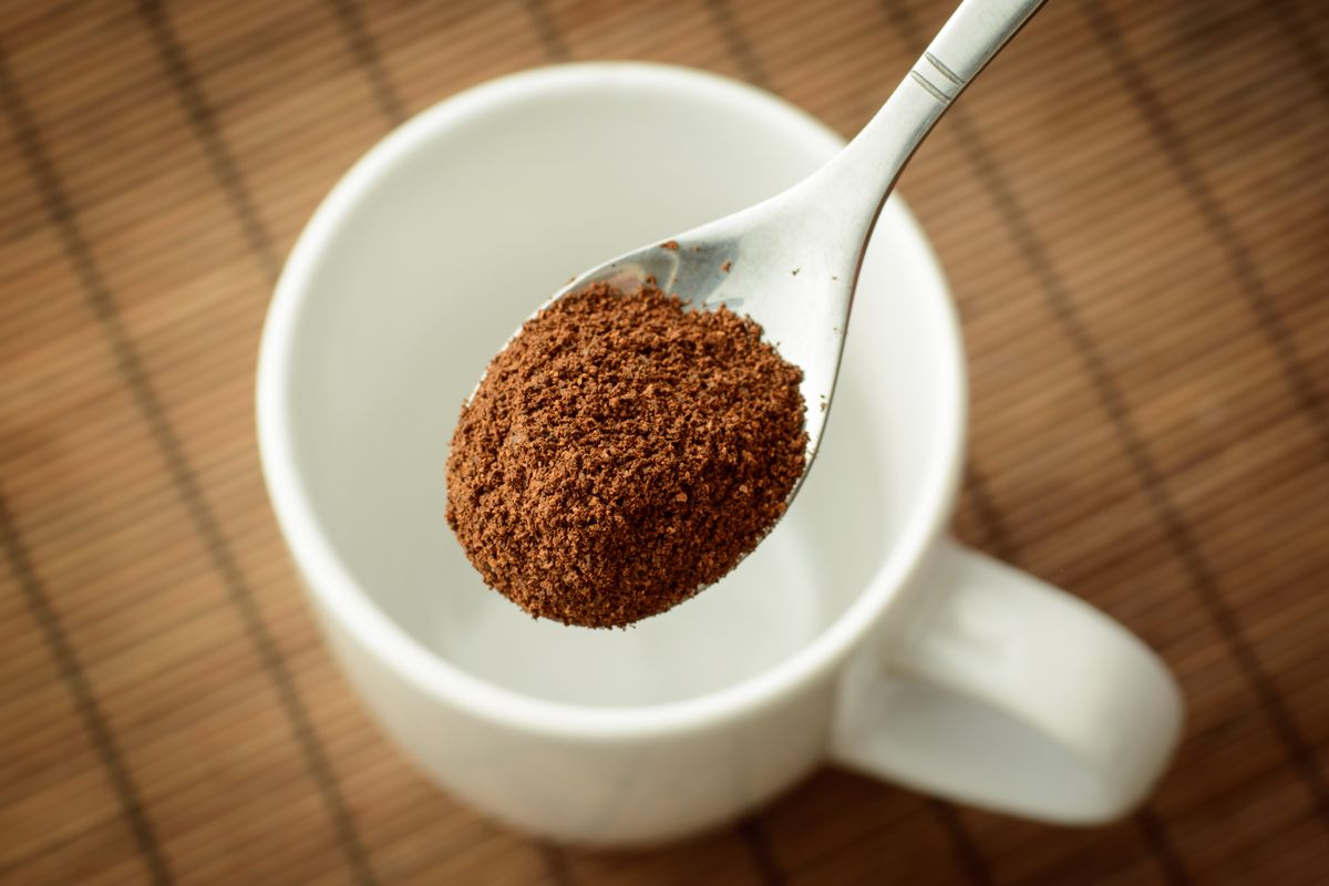 A spoonful of instant coffee on a spoon.