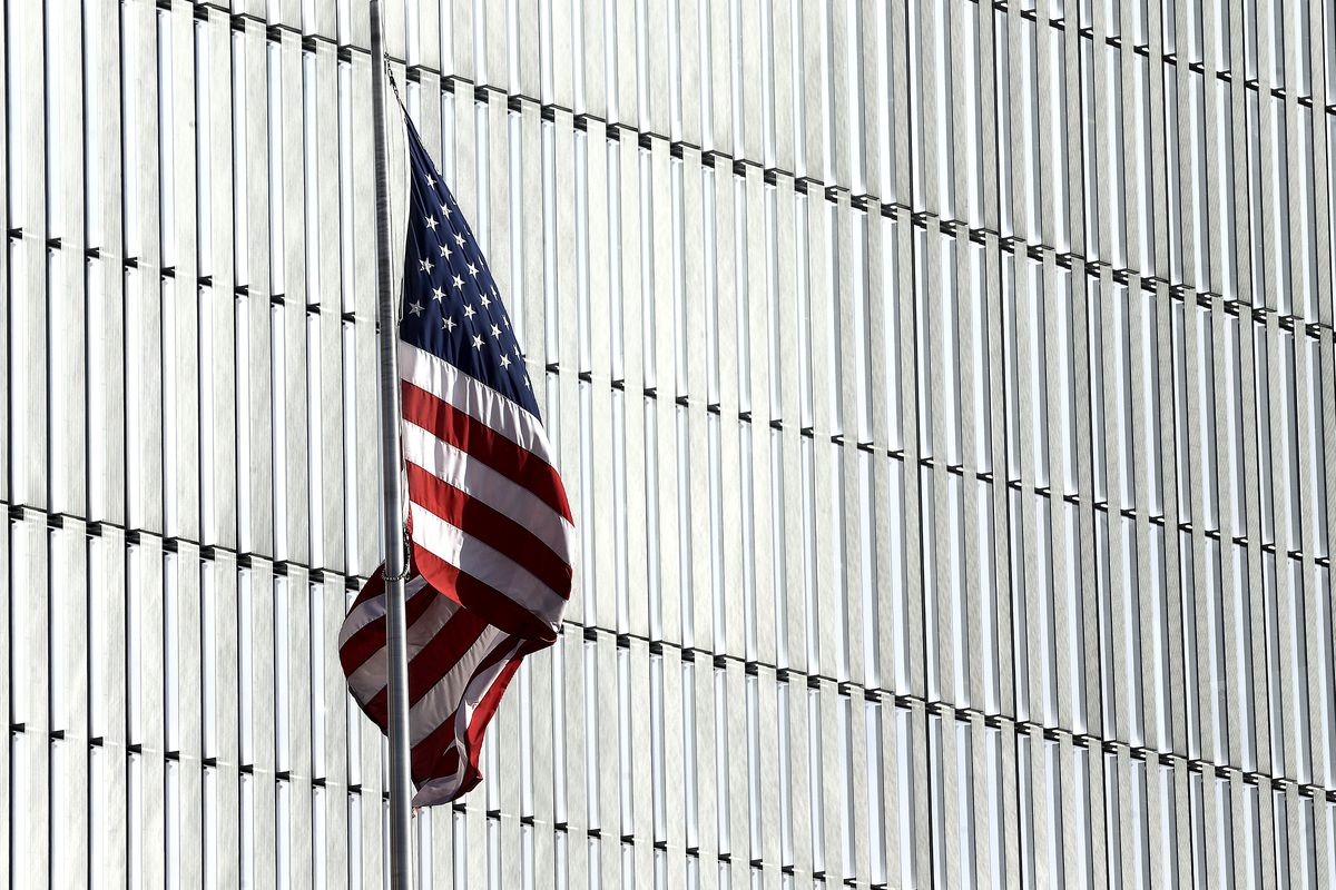 A flag flies in front of the federal courthouse in Salt Lake City on Tuesday, Feb. 18, 2020.