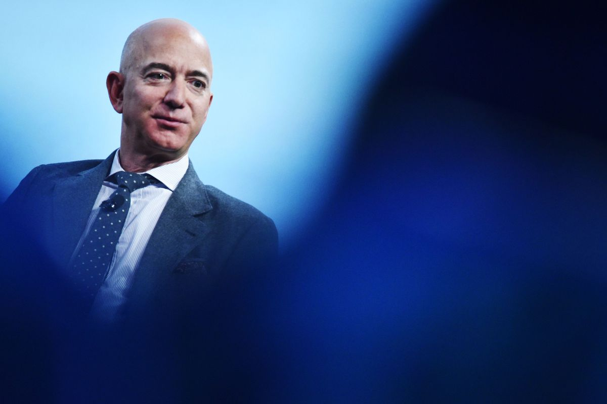 Jeff Bezos wears a suit.