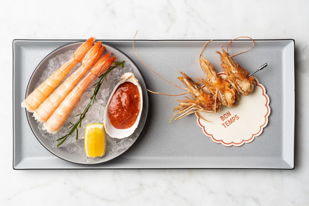 A tray holding high end prepared shrimp several ways.
