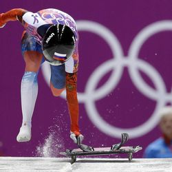Elena Nikitina of Russia starts her third run during the women's skeleton competition at the 2014 Winter Olympics, Friday, Feb. 14, 2014, in Krasnaya Polyana, Russia.