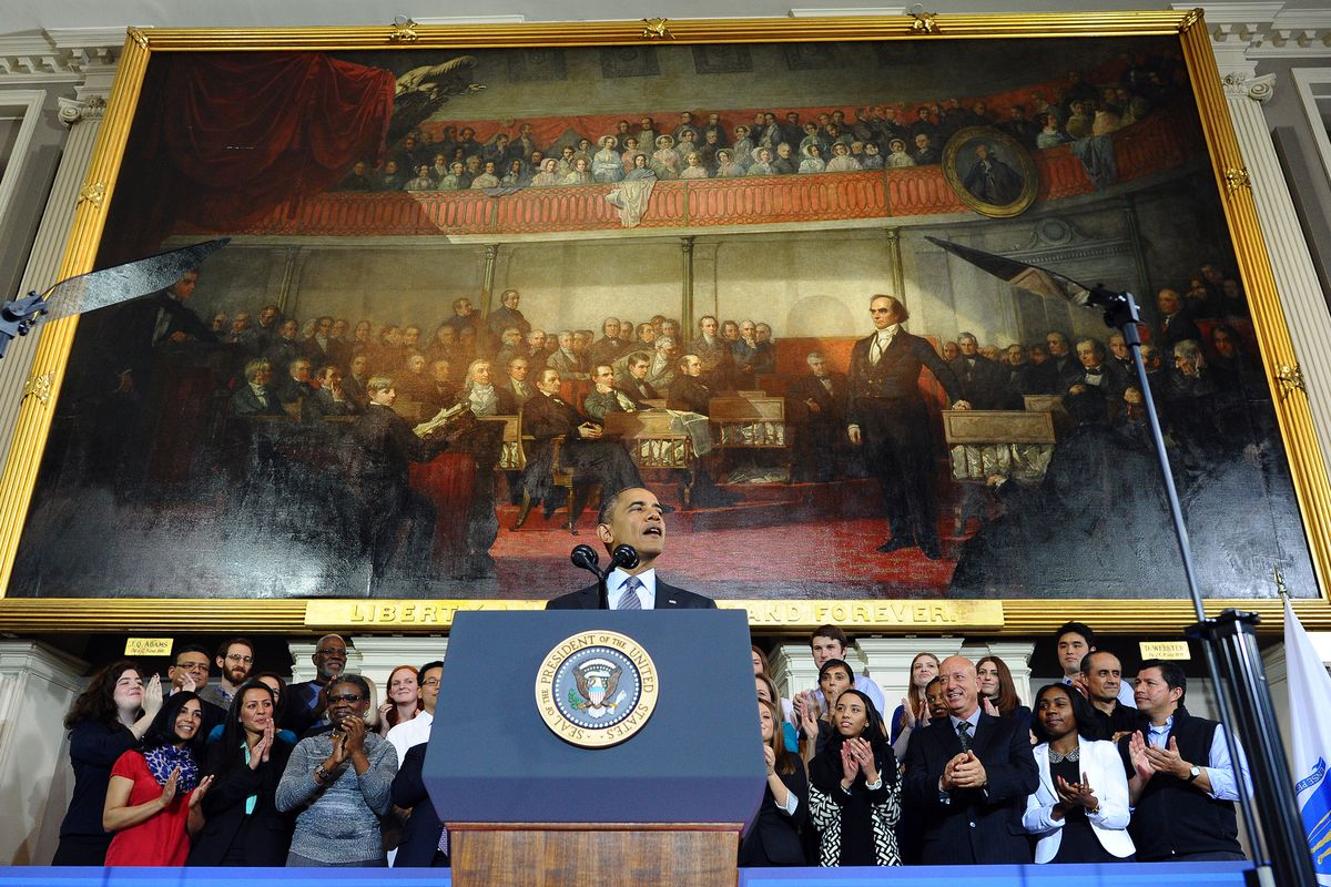President Barack Obama speaks at Faneuil Hall on the implementation of the Affordable Health Care Act October 30, 2013 in Boston.