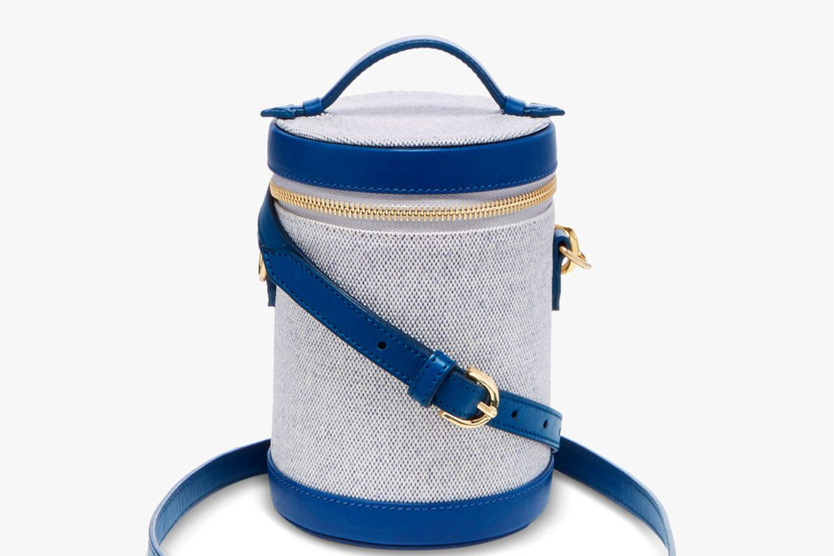 A gray and blue cylindrical purse