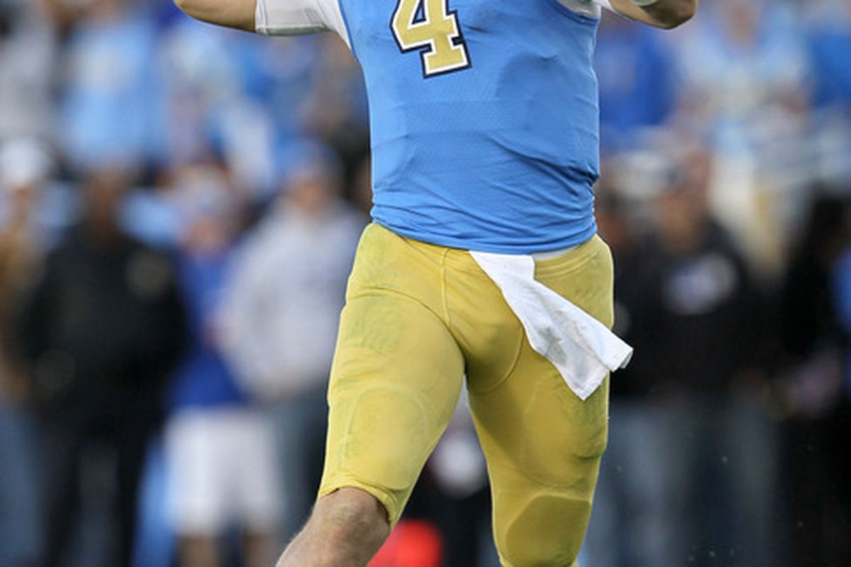 PASADENA, CA - NOVEMBER 05:  Quarterback Kevin Prince #4 of the UCLA Bruins thorws a pass as he scrambles against the Arizona State Sun Devils at the Rose Bowl on November 5, 2011 in Pasadena, California.  (Photo by Stephen Dunn/Getty Images)