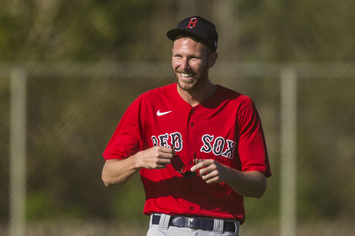 Boston Red Sox pitcher Chris Sale warms up during the first day Spring Training for the full squad at Jet Blue Park in Fort Myers on Monday, February 22, 2021. He is recovering from Tommy John surgery and is it is uncertain when he is returning.